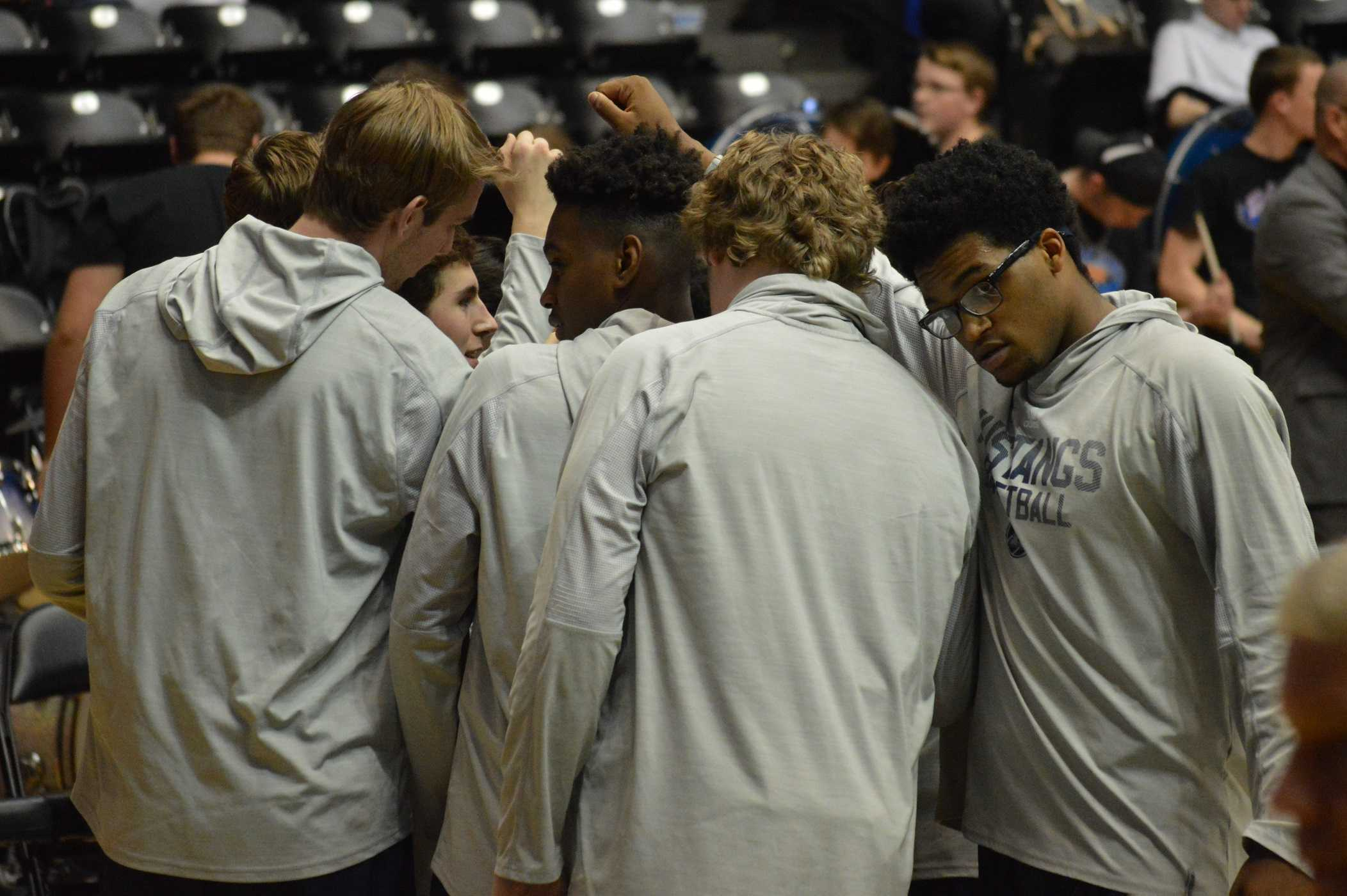 The team huddles together in preparation for the game.